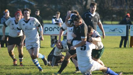 Robbie Gray in the thick of the action during the tradtional Boxing Day match at Holt Rugby Club. Pi