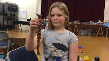 Millie Hannah after having her hair cut off at an event at Cromer Parish Hall. Picture: Stuart Ander