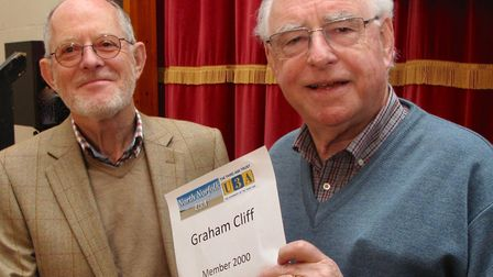 North Norfolk U3A chairman Vic Cocker presents Graham Cliff with a certificate marking him as the gr