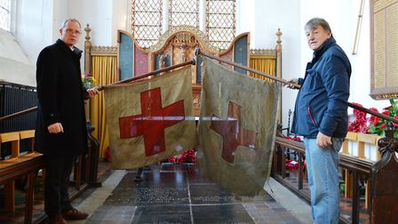The Rev Paul Cubitt and Keith Jarvis with the old North Walsham First World War flags they would lik