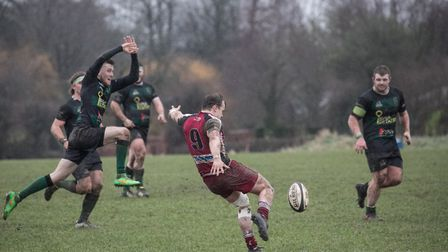 North Walsham's Tom Younie moves in to block an attempted clearance during Saturday's defeat at Amer