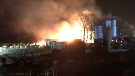 Around 60 firefighters are tackling a blaze at North Walsham Industrial Estate. Picture: Matthew Kno