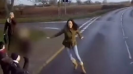 She runs into the road in an attempt to keep the children back. Picture: www.hdvdashcamfootage.com