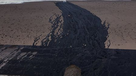 The black substance seen on the beach. Picture: Julia Holland