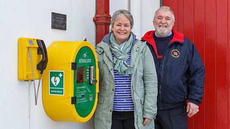 Sheringham Lifeboat operations manager Brian Farrow and Joanne Stone with the defibrillator installe