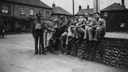 A group of lads on the Vernon Arms wall in Southrepps during the 1940s. Picture: Courtesy of the Sou