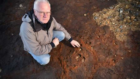 Russell Yeaomans pictured at West Runton beach where he found some fossilised human footprints.Pictu