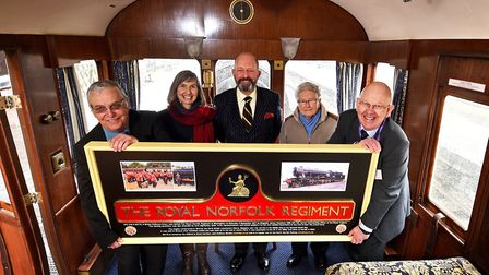 Presentation of the third nameplate cast for The Royal Norfolk Regiment locomotive. Left to right, N