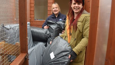 RSPCA East Norfolk branch manager, Debs Cook, back, receives donations of beds and toys from Daisy K