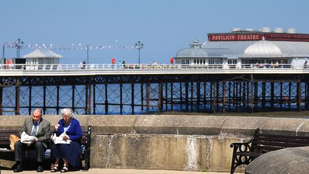 A couple enjoying fish and chips in the sunshine on Cromer promenade. Photo: Antony Kelly