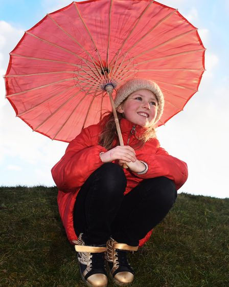 Orla Goodson, ten, ready to parade with her mum and the red parasols at Cromer as 100 women get toge