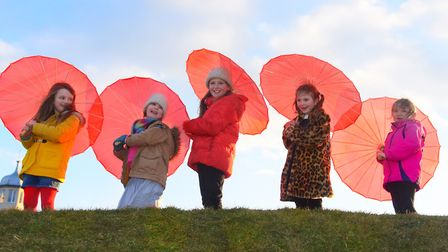 Ready to parade with their mums and their red parasols at Cromer as 100 women get together for Inter