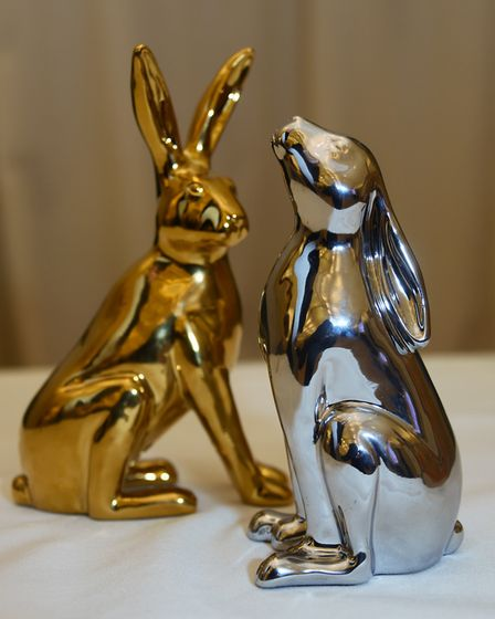 A small-scale version of what Chrome-hare looks like, along side a golden 'ears-up' hare figurine. P