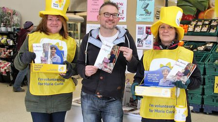 Stalham author raises money for Marie Curie charity. From left:-Susan Mingay (Marie Curie), Paul Sta