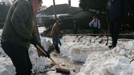Community heroes in Cawston village help clear metre-deep snow drift to get children to school safel