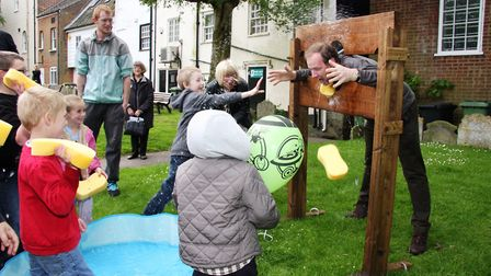 Visitors enjoyed the last North Walsham Children's Day in 2015. Here, the Rev Paul Cubitt gets a soa