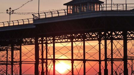 Cromer Pier shown on this silhouette at sunrise Photo: Peter Dent