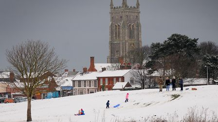 Sledging in the snow at Meadow Park, Cromer PHOTO: ANTONY KELLY