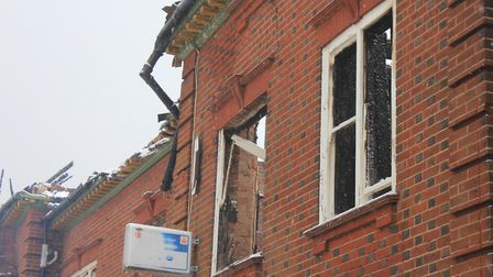 The burnt out top floor and roof. Photo: KAREN BETHELL