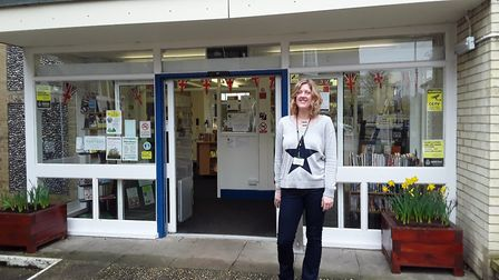 Sara Caistor, Holt Library's manager, in front of the building in Church Street. Picture: Courtesy o