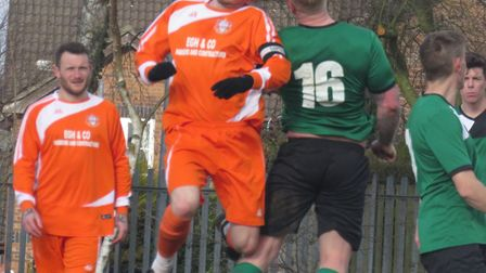 Pilgrims' skipper Jack Crane, watched by George Edge, tussles with a couple of Horsford players. Pic
