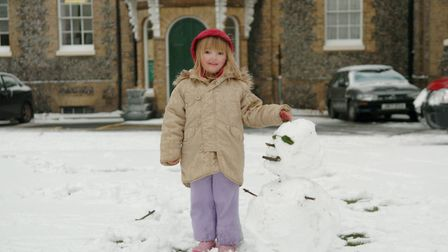 Cromer Town Centre, CromerSnow in Cromer, Charlotte Mitchell (4) builds a snowman next to North Lodg