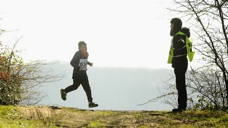 The runners are shown the way by a marshall during the Juniors race of the Hunny Bell Cross Country