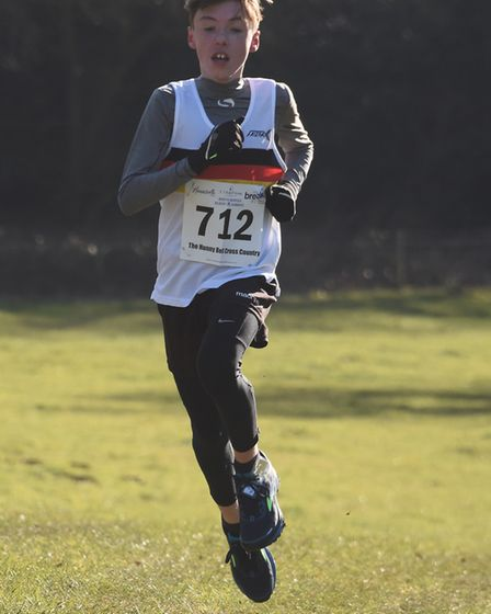 The lead runner nears the finish line in the Juniors race of the Hunny Bell Cross Country 2018, at t