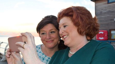Chrissie Robertson, right, taking a selfie as Barbara Castle with fellow Made in Dagenham cast membe