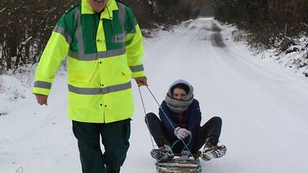 A Stalham First Responder enjoying the snow with his family. Picture: Tim Thirst