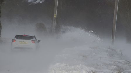 A car slams into a snowbank in Mundesley. Picture: Christon Iliffe