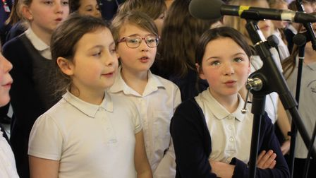 Sheringham Primary School junior choir members rehearsing the Rod Stewart song Sailing with local gr