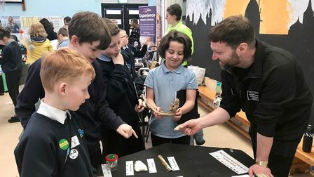 Year 6 pupils chatting to staff from Norfolk Wildlife Trust at Cromer Junior School's annual careers