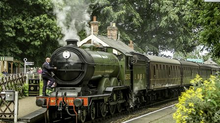 Green steam train on the Poppy Line at Holt Station Photo: Richard Brunton