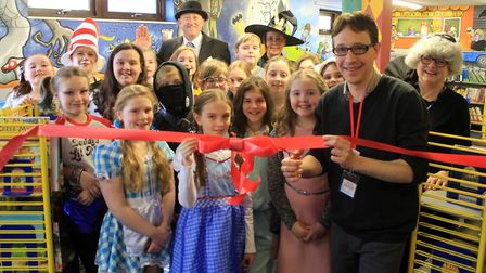 Norwich-based children's author Benjamin Scott cuts the ribbon at the opening of Cromer Junior Schoo
