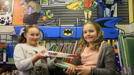 Cassie, 10 and Grace, 11, browsing the shelves of Cromer Junior School's newly-revamped library. Pho