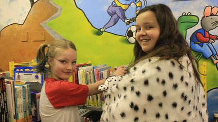Emma, 10, and Grace, 11, browsing the shelves of Cromer Junior School's newly-revamped library. Phot