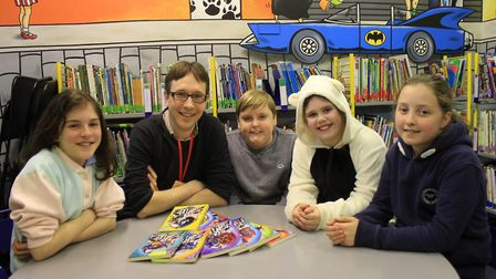 Norwich-based children's author Benjamin Scott shares one of his Star Fighters books with pupils at