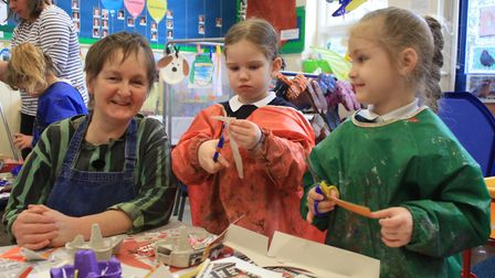 Holt Primary School reception pupils working on their egg box owls with artist Jessica Perry. Photo: