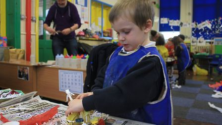 Holt Primary School reception pupil Alex working on his egg box owl, which will go on show during Ho