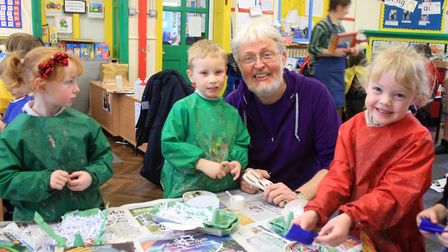 Falcon arts organisation founder Phil Barrett helping Holt Primary School reception pupils with thei