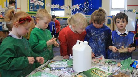 Holt Primary School reception pupils working on their egg box owls, which will go on show in shop wi