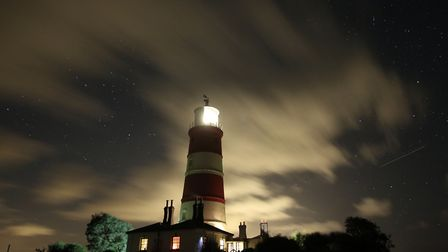 Lighthouse in all its glory at night , slow moving clouds. Picture: Jason Gardiner