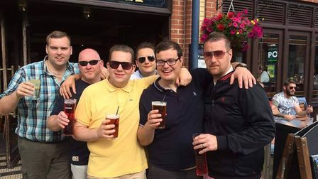 Matthew Mills ran a half-marathon after losing 7st in 10 months. Pictured with friends outside the T