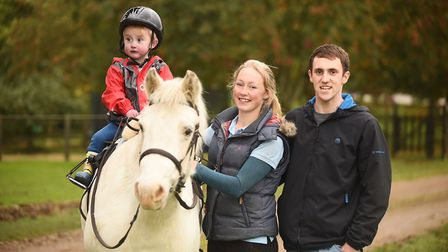 Charity horse ride in North Creake. Pictured is toddler Kaiden Griffin with his parents Kyra Welch a