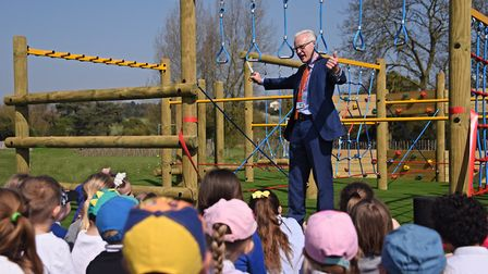 MP Norman Lamb celebrates after cutting the ribbon to open the new play equipment at Mundesley Junio