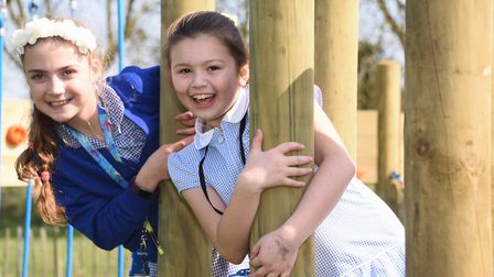 Mundesley Junior School pupils Tilly, left, and Daisy, enjoying the new play equipment. Picture: DEN