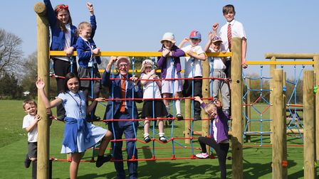 MP Norman Lamb and members of the school council enjoy the new play equipment at Mundesley Junior Sc