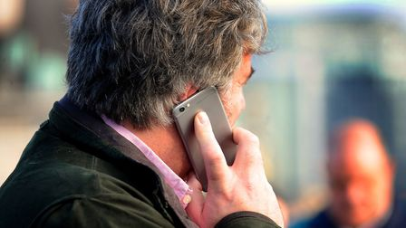 Man using a mobile phone. Photo credit: Lauren Hurley/PA Wire