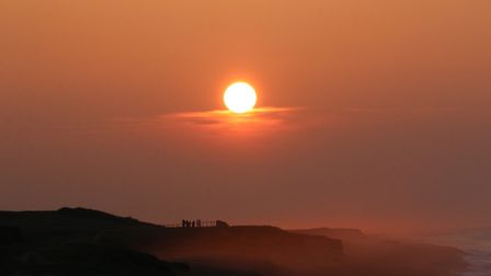 After a week of mist a clear sky gave us a lovely North Norfolk sunset with people enjoying a walk a